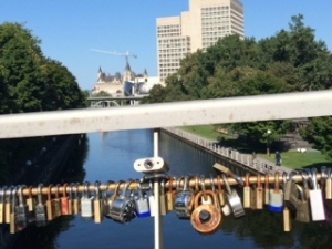 Illustration: Photo of locks on pedestrian bridge over Rideau Canal in downtown Ottawa