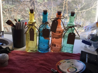 Colored bottles in a window photo